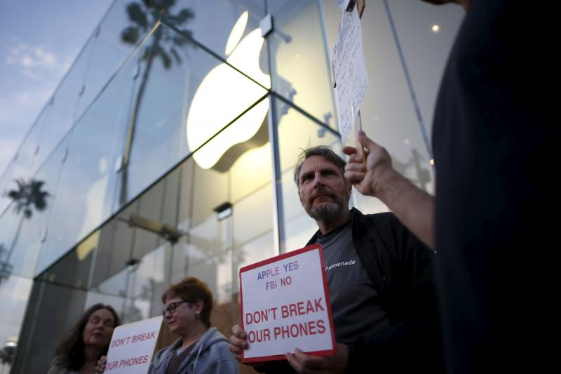 People gather at a small rally in support of Apple, in Santa Monica, California, February 2016.
