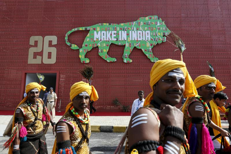 """Performers walk at the exhibition centre of the """"Make In India"""" week in Mumbai, India, February 13, 2016."""