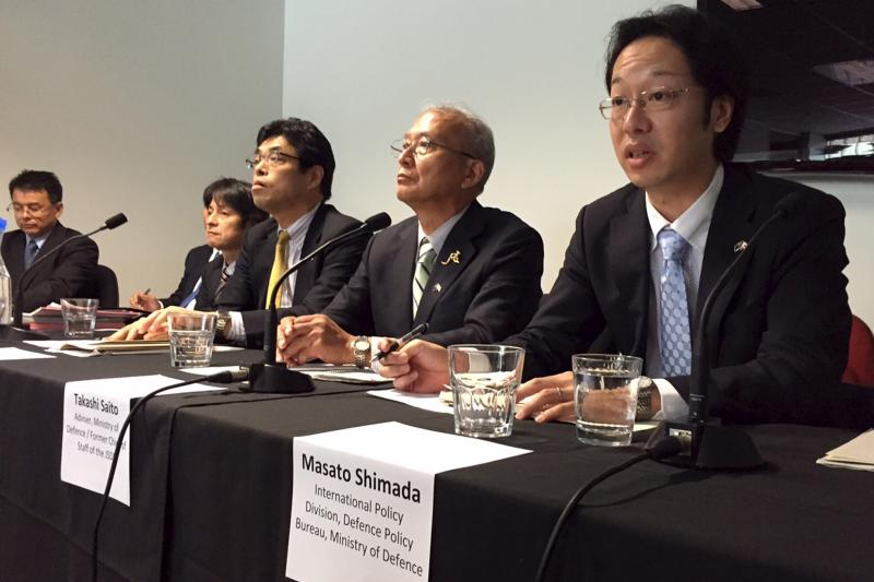 Takashi Saito (2nd R), head of a Japanese consortium eyeing one of the world's most lucrative defense contracts, speaks at a news conference in Adelaide, South Australia, August 26, 2015.