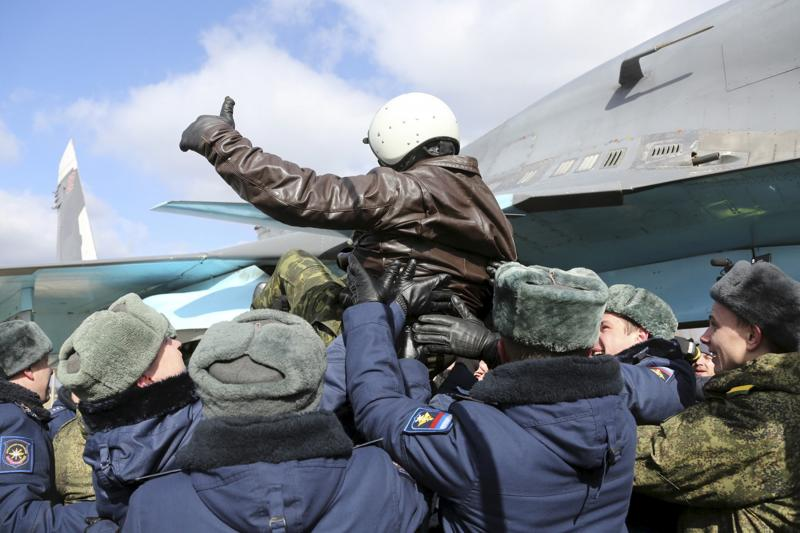 A Russian military pilot is greeted upon his return from Syria to a home airbase during a welcoming ceremony in Buturlinovka in Voronezh region, Russia, March 15, 2016.