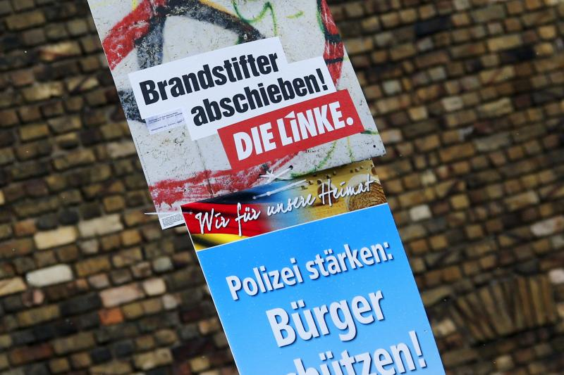 """Election posters of Die Linke party (top) which reads """"Deport arsonists"""" and of right-wing Alternative for Germany (AfD) party which reads """"Reinforce the Police: Protect the citizens"""" for the upcoming Saxony-Anhalt state elections are pictured in Bitterfe"""