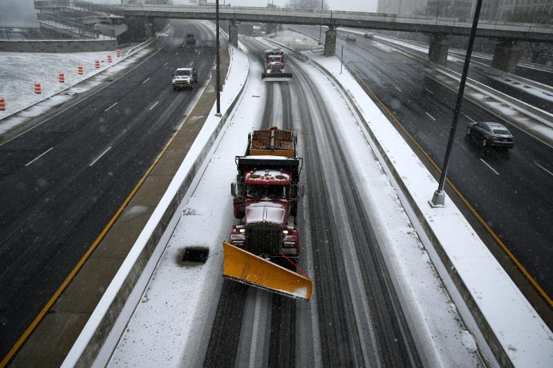 Snowplows clear snow from roads in Washington, D.C., January 2016.
