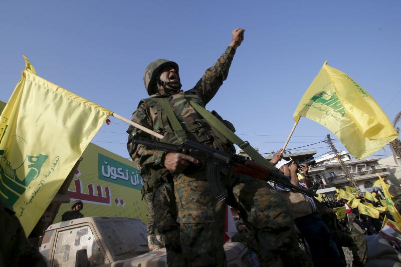 A Hezbollah member reacts while Hezbollah leader Sayyed Hassan Nasrallah talks on a screen during a televised speech at a festival celebrating Resistance and Liberation Day, in Nabatiyeh May 24, 2015.