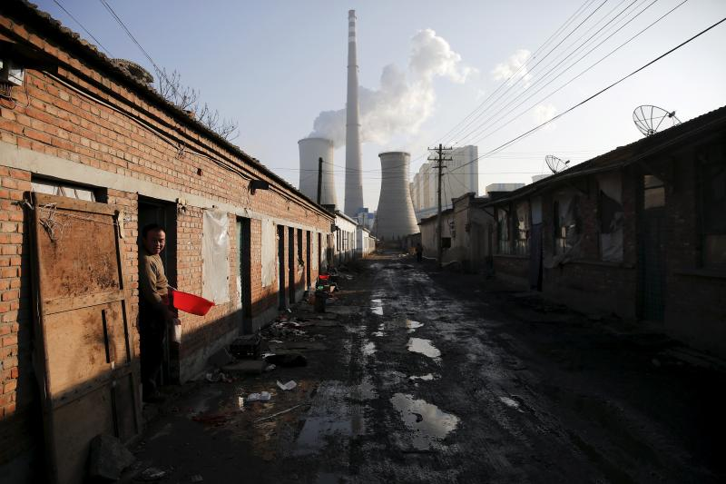 Near a coal-fired power plant in Beijing, December 2015. China is pumping out too much coal, steel, copper wire, and other industrial products.