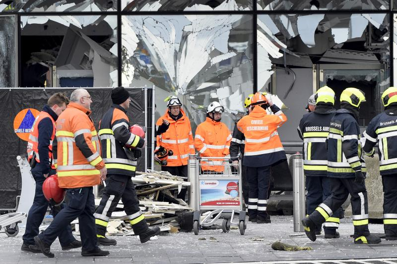 Broken windows of the terminal at Brussels airport are seen during a ceremony following bomb attacks in Brussels in Zaventem, Belgium, March 23, 2016.