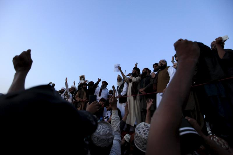 Leaders of Islamist activists talk to their supporters as they announced the end of their sit in protest against the execution of Mumtaz Qadri, a policeman turned criminal, after negotiations with the government outside the Parliament building in Islamaba