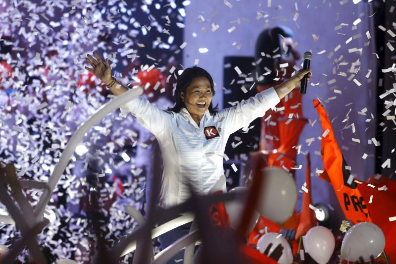 Peruvian presidential candidate Keiko Fujimori greets supporters during a campaign rally in Lima, March 18, 2016.