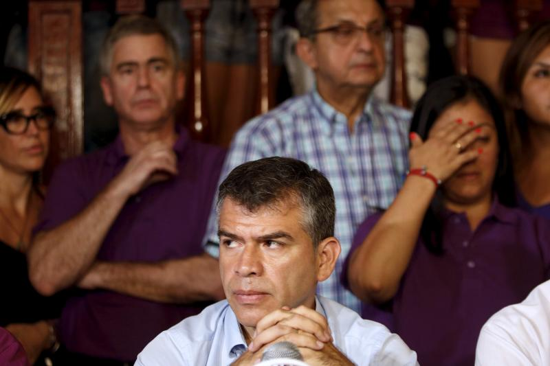 """Peru's presidential candidate Julio Guzman attends a news conference after the Special Jury of Elections, which approves presidential tickets, accepted a citizen's petition to declare Guzman's candidacy """"inadmissible"""" for upcoming April elections, in Lima"""