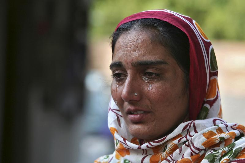 Bhinder Kaur, widow of Kuldeep Singh, a cotton farmer who committed suicide, weeps at her residence during an interview with Reuters on the outskirts of Bhatinda in Punjab, India, October 28, 2015.