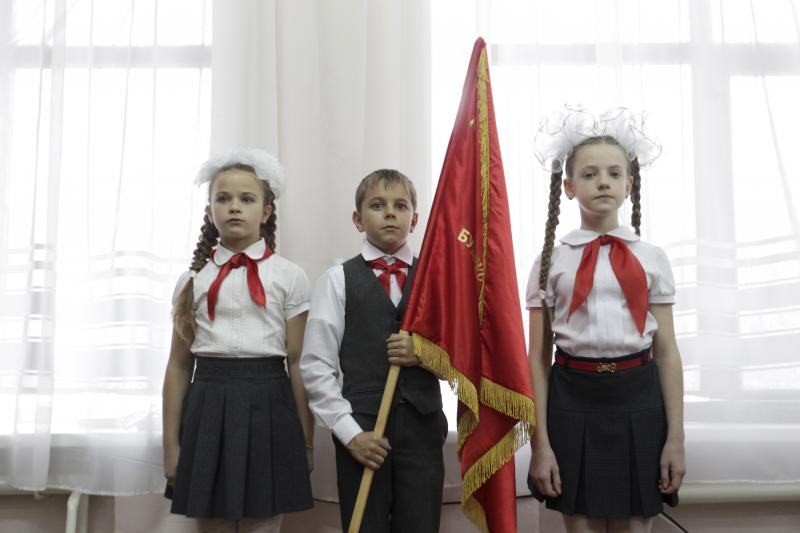 An inauguration of new members of the Pioneer Organization at a school in Stavropol region, Russia, November 2015.