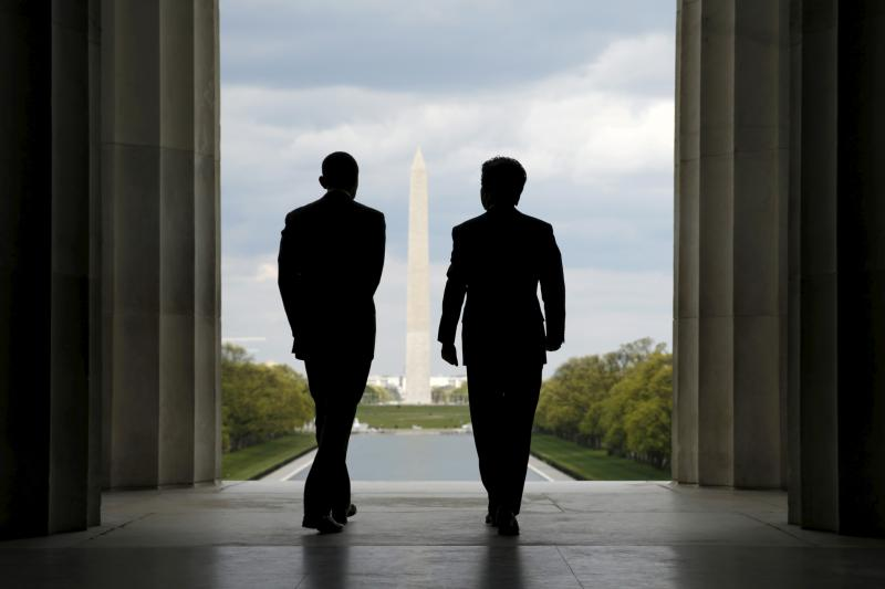 U.S. President Barack Obama and Japanese Prime Minister Shinzo Abe visit the Lincoln Memorial in Washington, with the Washington Monument in the background April 27, 2015.