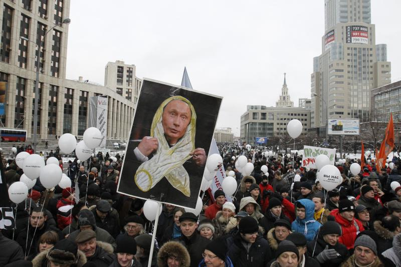 Demonstrators protest against parliamentary election results in Moscow, December 2011.