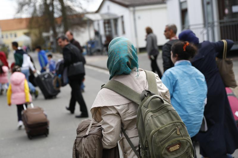 Syrian refugees arrive at the camp for refugees and migrants in Friedland, Germany, April 2016.
