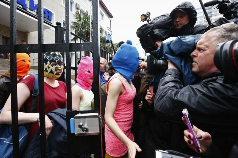 Masked members of Pussy Riot leave a police station in Adler during the 2014 Sochi Winter Olympics, February 2014.