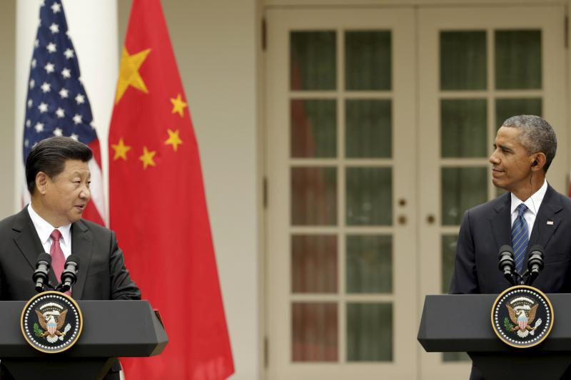 Obama and Xi hold a joint news confernce in the Rose Garden of the White House in Washington, September 2015.