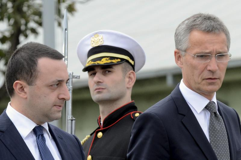 NATO Secretary General Jens Stoltenberg (R) and Georgian Prime Minister Irakly Garibashvili attend an opening ceremony of the joint training and evaluation center at the Krtsanisi settlement outside Tbilisi, Georgia, August 27, 2015.