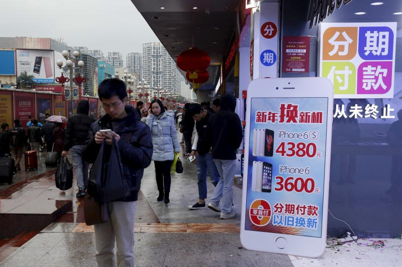 A man checks his smartphone in Shenzen, China, January 2016. China's success may be seen as the ultimate triumph of the West.