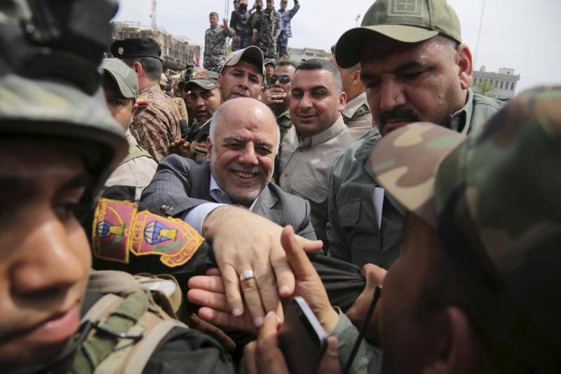 Iraq's Prime Minister Haidar al-Abadi tours the city of Tikrit after Iraq security forces regained control from Islamist State militants, April 2015.