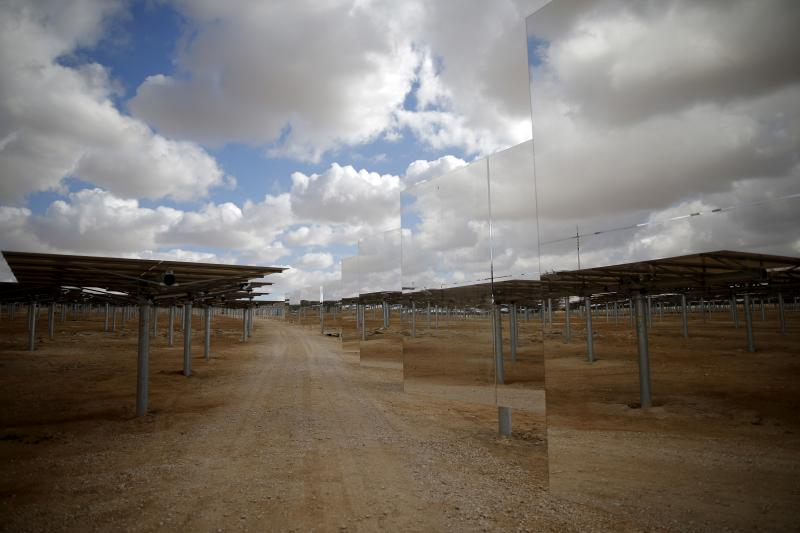 Heliostat mirrors reflect their surroundings in a field at the construction site of a 240 meter (787 feet) solar-power tower in Israel's Negev Desert, February 2016.