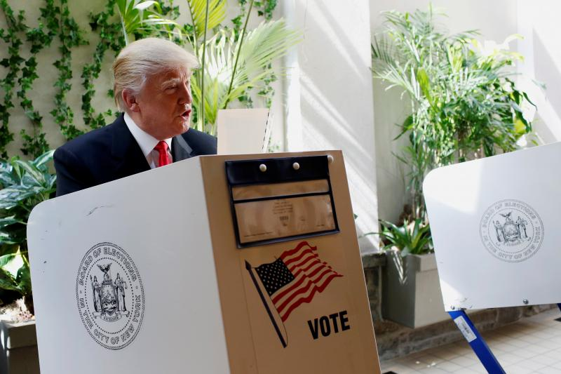 Republican presidential candidate Donald Trump fills his ballot for the New York primary election in the Manhattan borough of New York City, U.S., April 19, 2016.