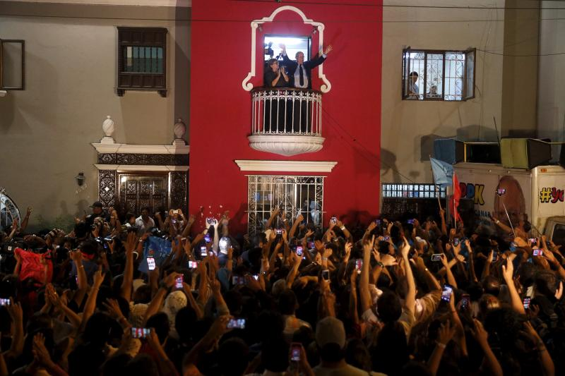 Pedro Pablo Kuczynski waves to supporters at his headquarters in Lima after the election, April 2016. Kuczynski has struggled to appeal to rural voters.