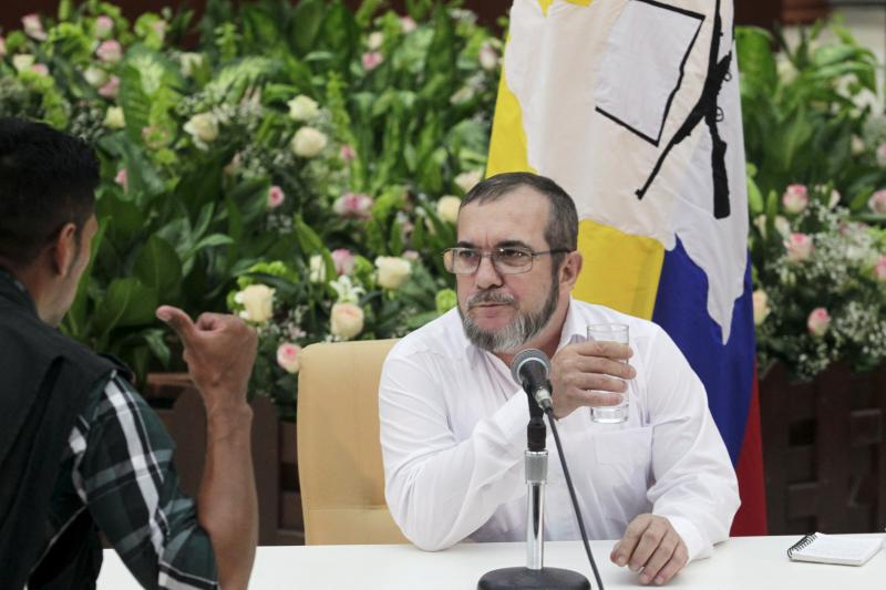 FARC rebel leader Rodrigo Londono (R), better known by the nom de guerre Timochenko, speaks at a news conference after a meeting with Colombia's President Juan Manuel Santos and Cuba's President Raul Castro in Havana, September 2015.