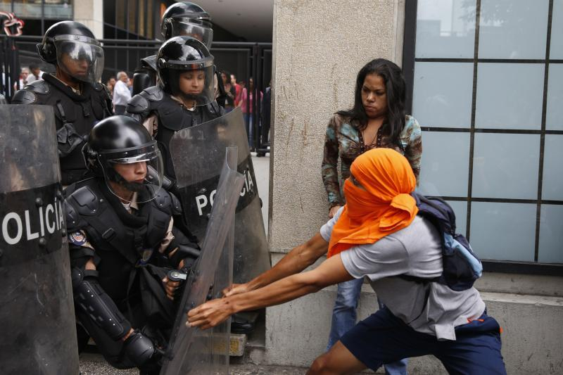 An anti-government protestor clashes with police in Caracas, May 2014.