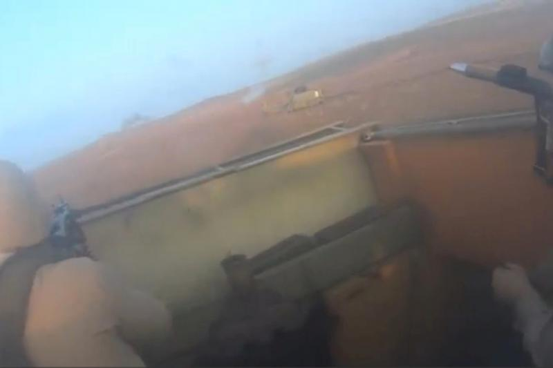 ISIS fighters are seen inside a vehicle in Iraq, in this still image taken from an amateur video supplied by Kurdish Peshmerga and received by Reuters on April 29, 2016.