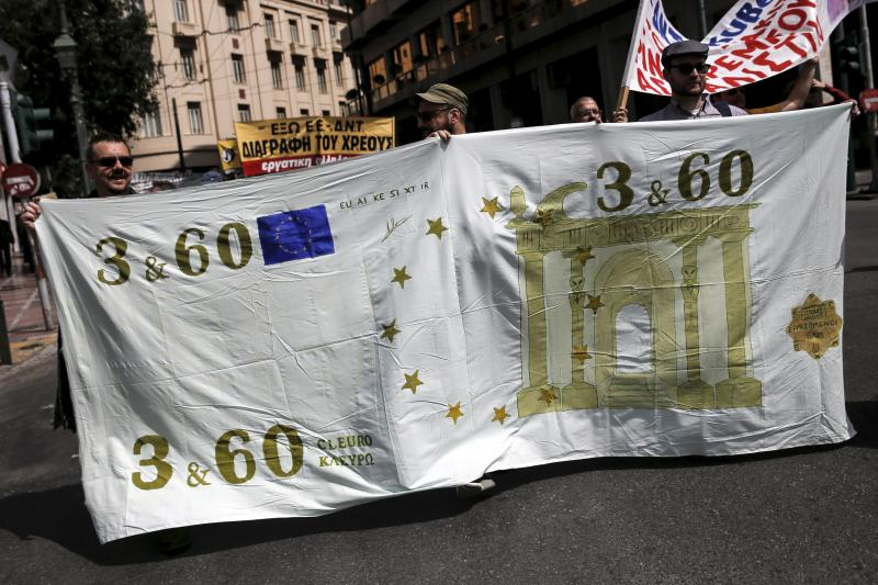 Protesters hold a banner depicting a mock Euro banknote during a demonstration marking a 24-hour strike of the country's biggest public sector union ADEDY against planned tax and pension reforms in Athens, Greece, April 7, 2016.