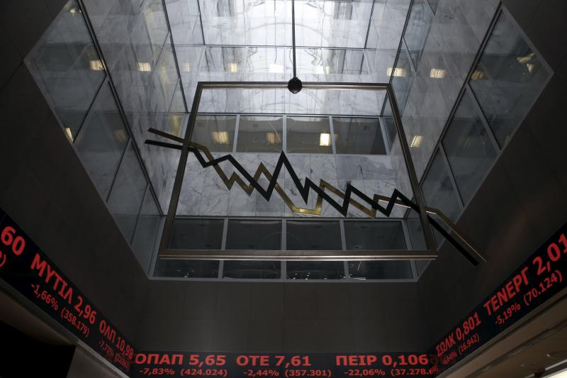 A stock ticker shows stock options making losses at the lobby of the Athens stock exchange building in Athens, Greece, February 8, 2016.