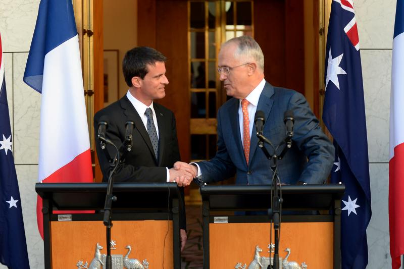 Australian Prime Minister Malcolm Turnbull (R) shakes hands with the Prime Minister of France Manuel Valls after a joint news conference at Parliament House in Canberra, Australia, May 2, 2016.
