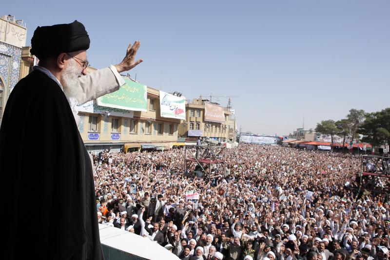 Iran's Supreme Leader Ayatollah Ali Khamenei waves to the crowd in the holy city of Qom, 75 miles south of Tehran, October 19, 2010.