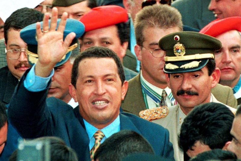 Venezuela's president-elect Hugo Chavez waves to crowds in downtown Bogota, December 18, 1998.