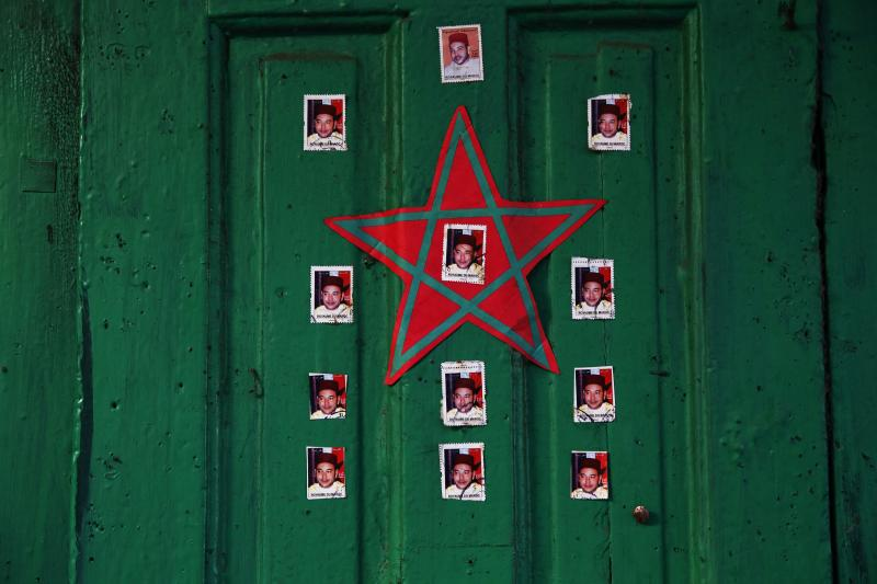Stickers with pictures of Moroccan King Mohammed VI decorate doors in national colours in Rabat's Medina, September 22, 2014.