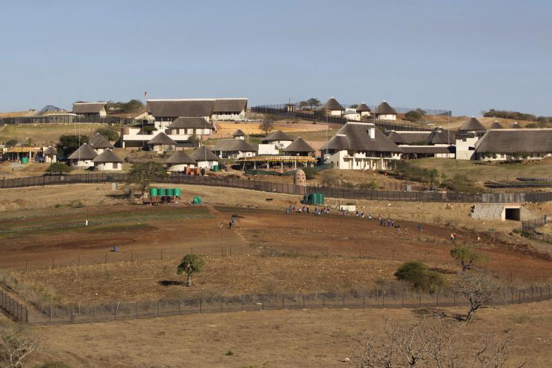 A general view of the Nkandla home (behind the huts) of South Africa's President Jacob Zuma, August 2012.
