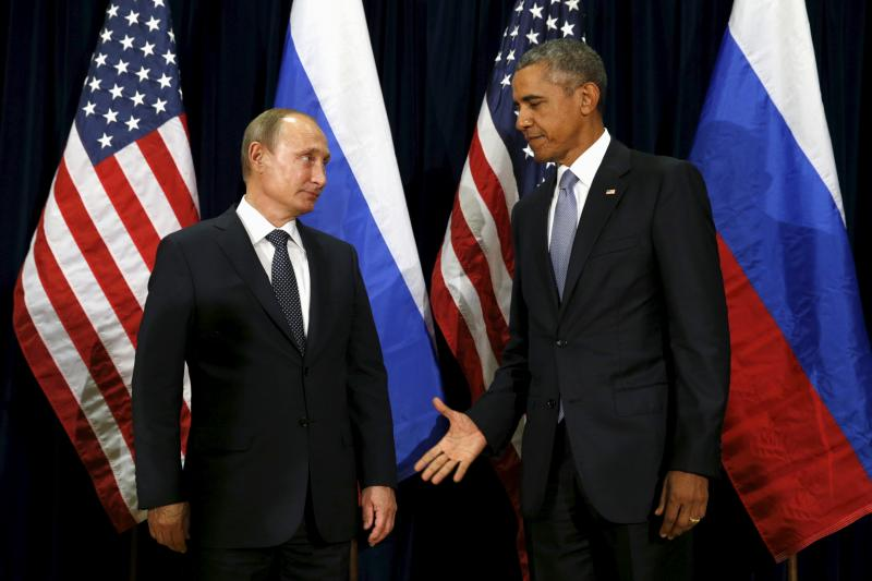 U.S. President Barack Obama extends his hand to Russian President Vladimir Putin during their meeting at the United Nations General Assembly in New York September 28, 2015.