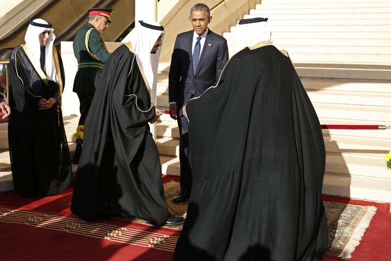 U.S. President Barack Obama participates in a receiving line with Saudi King Salman (3rd L) after arriving at King Khalid International Airport in Riyadh, January 2015.