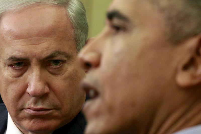 Israeli Prime Minister Benjamin Netanyahu listens as U.S. President Barack Obama speaks during their meeting in the Oval office of the White House in Washington, November 2015.