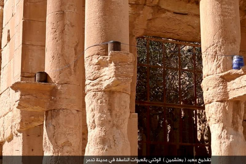 An image distributed by ISIS militants on social media on August 25, 2015 purports to show explosives on stone ledges of columns during what they said was the destruction of a Roman-era temple in the ancient Syrian city of Palmyra.