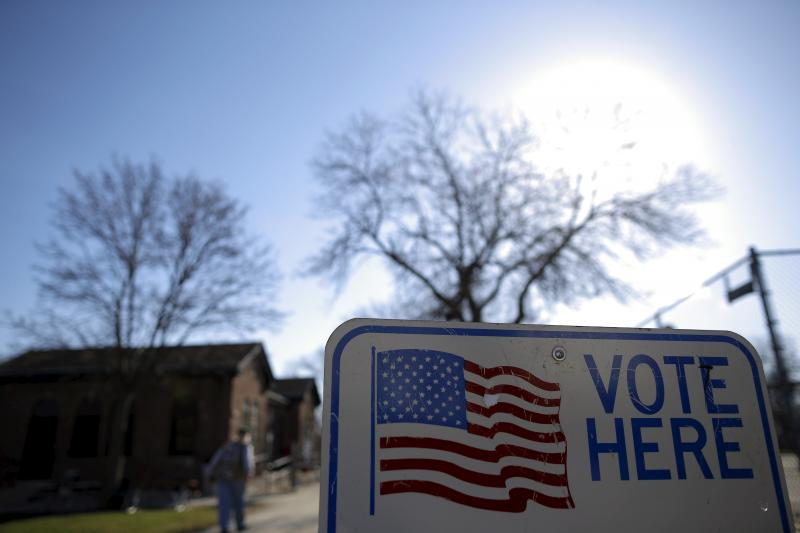 A voter arrives to cast their ballot in the Wisconsin presidential primary election at a voting station in Milwaukee, Wisconsin, April 2016.