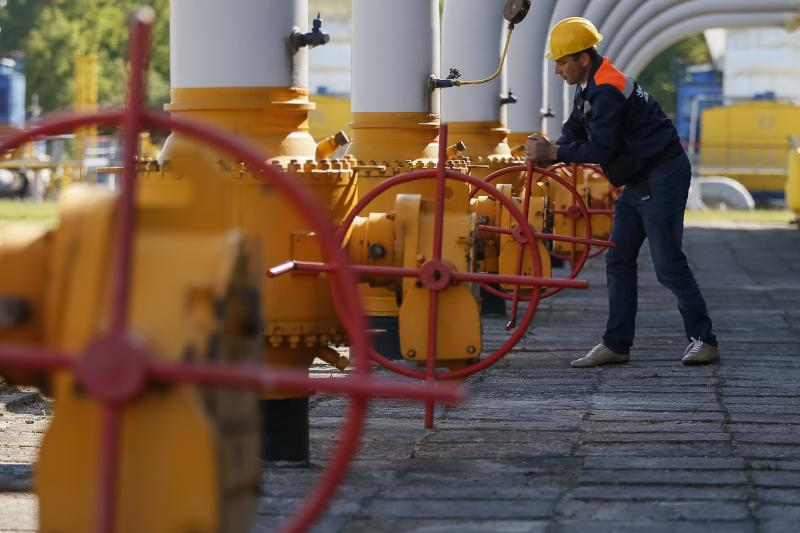A worker turns a valve at an underground gas storage facility near Striy, Russia, May 2014.