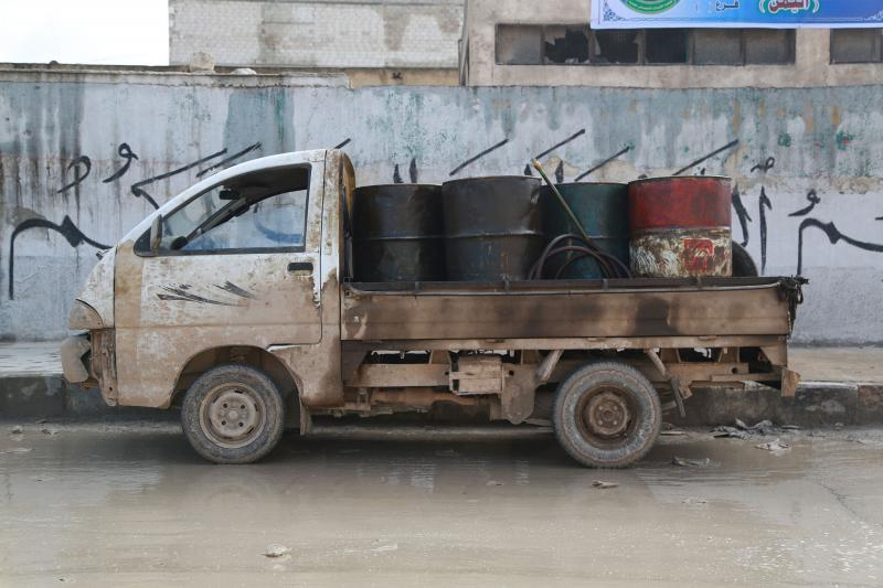 A pick-up truck carries fuel barrels for sale in the Aleppo countryside, January 2015.