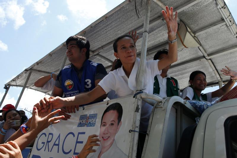 Presidential candidate Grace Poe waves as supporters reach out to her during election campaigning in General Mariano Alvares, Cavite, in the Philippines, May 3, 2016.