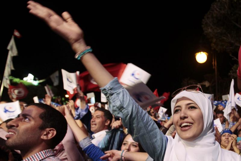 A supporter of the Islamist Ennahda movement shouts slogans during a campaign event in Tunis October 24, 2014.