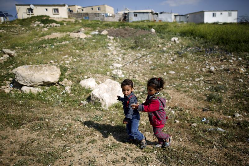 Bedouin children play in Umm el-Hiran, an unrecognized Bedouin village near the southern Israeli city of Beersheba, March 2016.