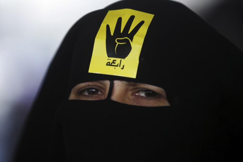"""A member of the Muslim Brotherhood and supporter of ousted Egyptian President Mohamed Mursi attends a protest and rally named """"The coup is terrorism"""" in the southern suburb of Maadi September 3, 2013."""
