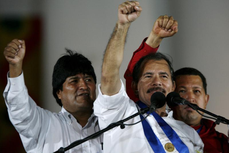 Nicaragua's President Daniel Ortega (C), Bolivia's President Evo Morales (L) and Venezuela's President Hugo Chavez raise their fists at a square in Managua after Ortega was sworn in January, 2007.