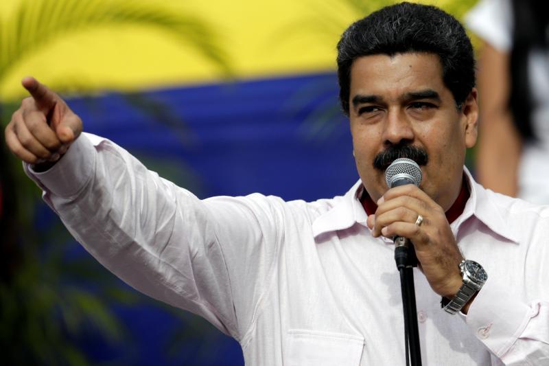 Venezuela's President Nicolas Maduro gestures as he speaks during a rally at Miraflores Palace in Caracas, Venezuela, June 2016.
