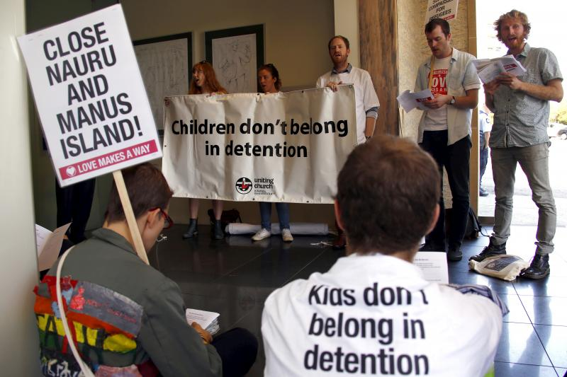 A group of around twenty protesters occupy Malcolm Turnbull's electoral office, demanding the end to the policy of offshore detention of asylum seekers in the Sydney suburb of Edgecliff, Australia, October 2015.