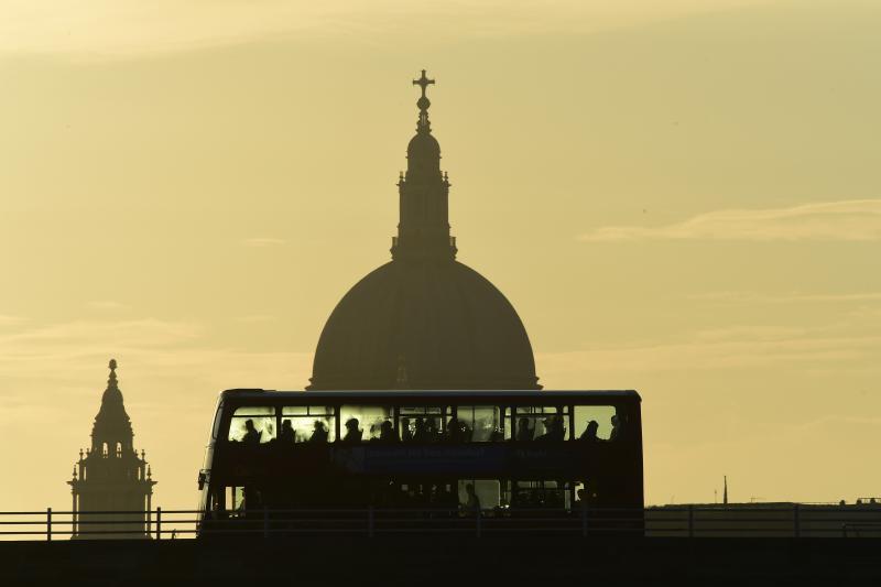 A bus carries commuters as it travels over Waterloo Bridge in London, Britain, June 24, 2016.